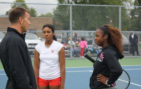 Ace Advice-  Sophomore Lauren Parker (left) and senior Kaela Mack receive advice from coach Don Baron. The team hosted Andrew for Senior Night on Tuesday and won 7-0.