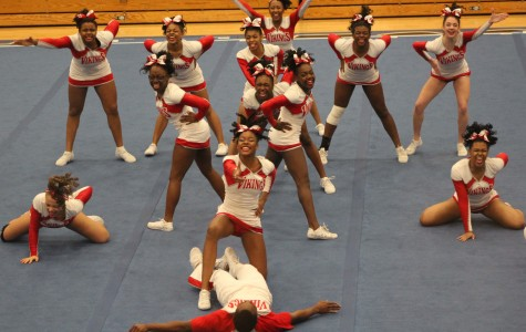 The varsity cheerleading team competes at Lincoln-Way East. The team will travel to Joliet West this coming Saturday for Sectionals.
