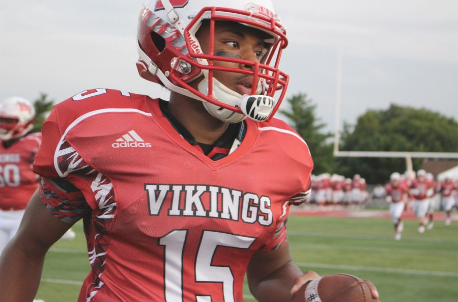 Senior Bryant Wright warms up pregame before playing Downers Grove South. H-F won 56-6.