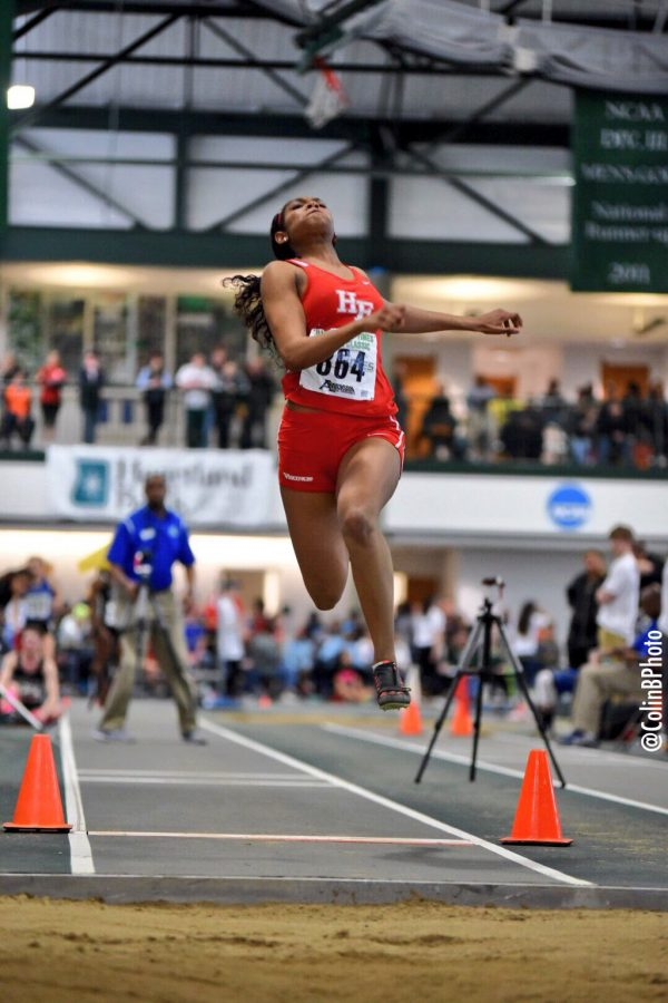 Senior Jamie Robinson participates in the long jump at Illinois Top Events.