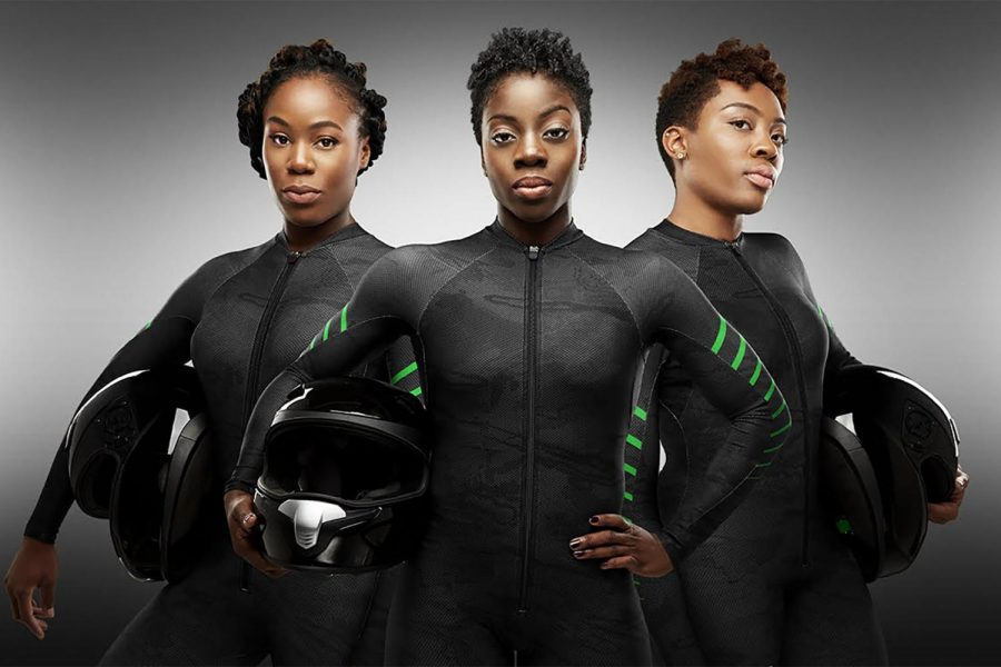 "Nigeria driver Seun Adigun (middle) and brakemen Akuoma Omeoga (left) and Ngozi Onwumere (right) in their team uniforms. The teams uses a wooden sled, the ""Maeflower,"" which Seun built herself and named after her late sister."