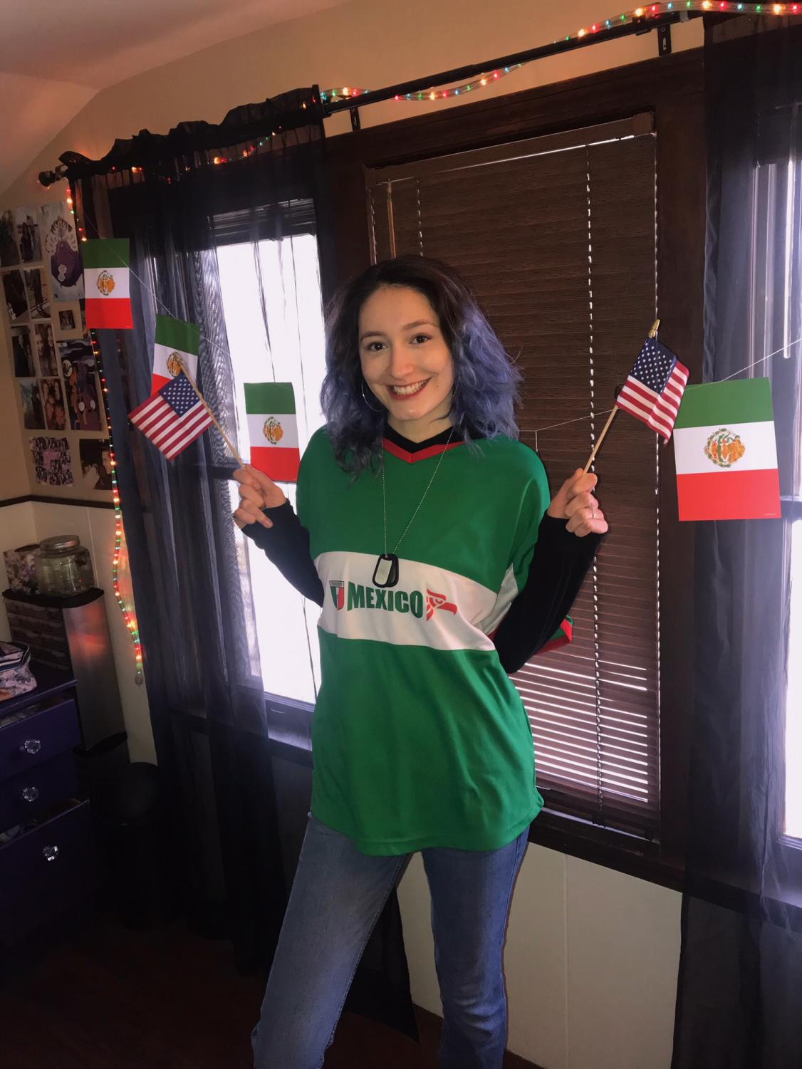 Dedicated to DACA   Junior Abigail Guerrero poses in her room with Mexican decor. She got involved in DACA after joining an organization named Increase the Peace.