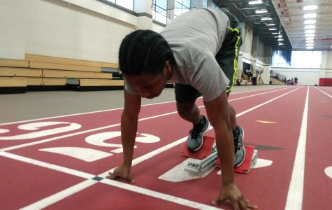 Sophomore sprinter Marshall Ellis practices his sprints at a practice in the field house. The varsity boys track team looks to get off to a fast start in a quad meet at the field house next Saturday.