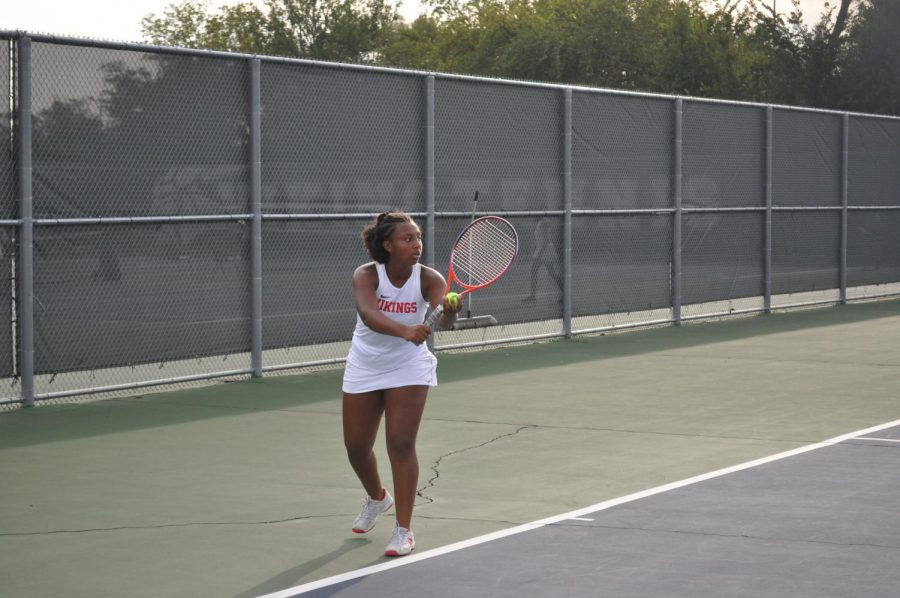 Junior+Lauren+Legardy+is+reaching+high+to+serve+to+her+opponent.+The+Vikings+beat+Lincoln-Way+West+in+Wednesday%E2%80%99s+match.