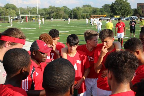 Assistant Coach Emmanuel Ali gives his team a pregame speech before their first home game against Richards last Thursday. The Vikings went on to beat the Bulldogs 2-0.