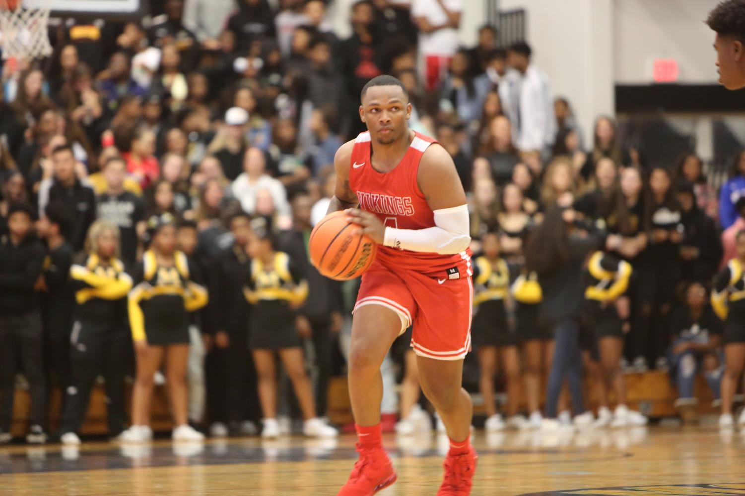 Handling Business  Senior Brandon Brewer handles the ball in the Chicago Heights Classic tournament gave vs. Marian Catholic on Nov. 27.