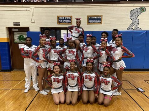 The Viking cheer team posing after their third place finish at Sectionals and securing a spot at state.