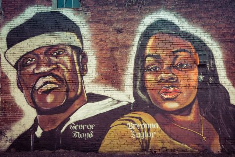 A mural of George Floyd and Breonna Taylor in Louisville, KY.