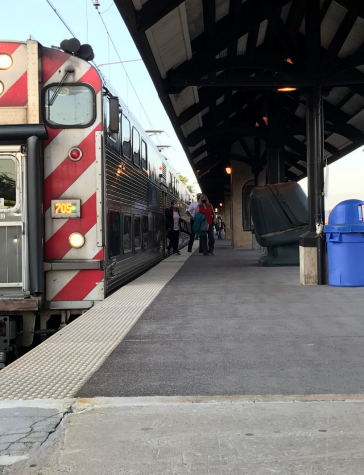 Commuters exit the Metra at the Homewood train station in tight groups with their companions to socially distance while also wearing masks.
