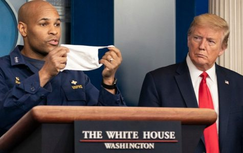 President Trump looks on as Surgeon General Jerome Adams urges citizens to wear masks.
