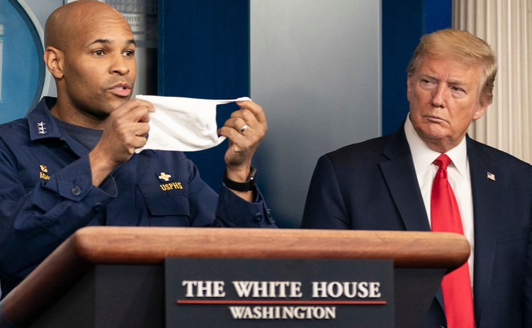 President+Trump+looks+on+as+Surgeon+General+Jerome+Adams+urges+citizens+to+wear+masks.+