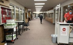 A Day at H-F.  A student heads towards the textbook center as H-F security guards check for student temperatures and self-certification forms from staff. As remote learning is in full swing at H-F, very few people are in the building on an average school day.
