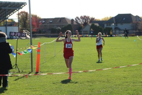 Schoen crosses the finish line to win the 3A Tinley Park Regional.