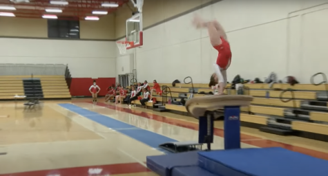 Senior Natalie Thompson competing in the vault event on Feb. 11, 2021.
