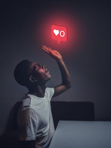 In the photo taken and created by Oladimeji Ajegbile, a man can be seen crying over  instagram likes. Which shows how people care way too much about social media.