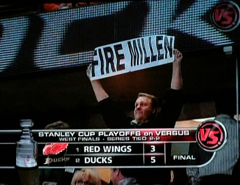 A fan attending game four of the NHL 2007 Western Conference Final Series, is seen holding up a sign showing his displeasure towards Detroit Lions GM Matt Millen, who finished the 2006-07 season with a record of 3-13.