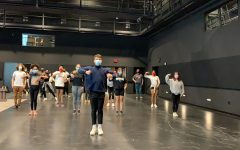 The cast rehearsing in the new Performing Arts Center.
