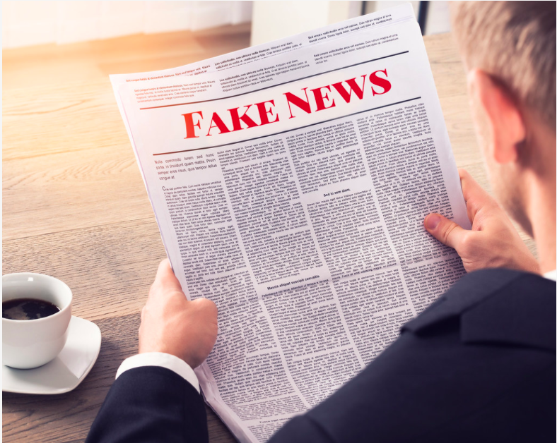 """Fake News - Person Reading Fake News Article"" by mikemacmarketing is licensed under CC BY 2.0"