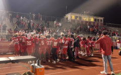 The Viking players saluting to the crowd, on homecoming night, after their 44-2 victory over Lincoln-Way Central.