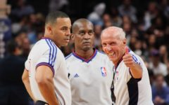 Three referees officiating at Madison Square Garden.